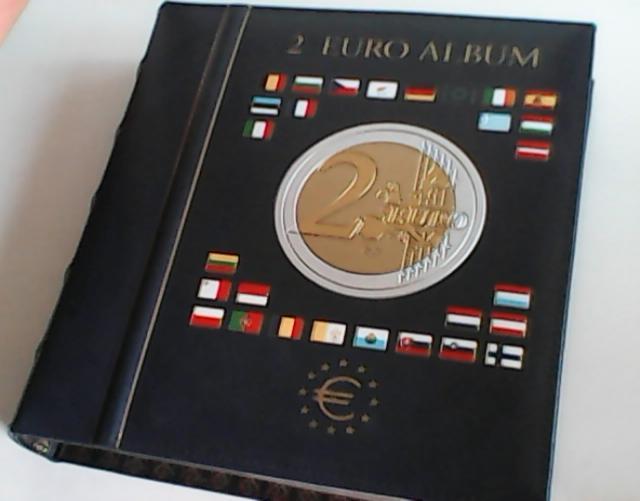 Продам альбом с монетами 2 евро