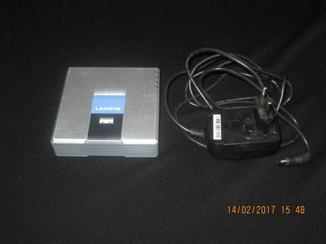 Продам телефонный адаптер Linksis spa 2102