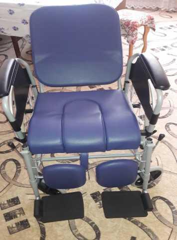 Продам Кресло-коляска с санитарным оснащением