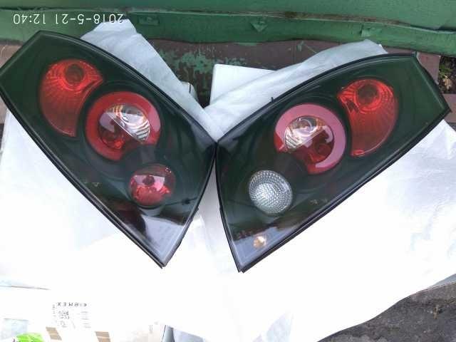 Продам Комплект задних фонарей