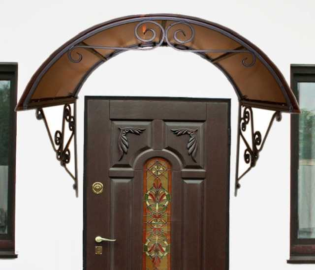 Продам козырек с элементами ковки над дверью