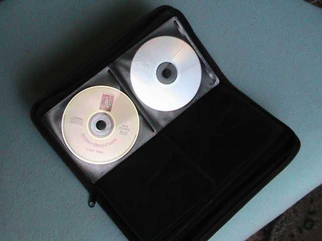 Продам: автоклатч для хранения CD & DVD дисков