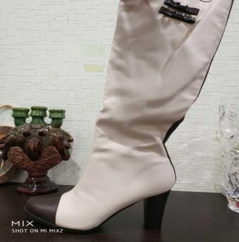 Продам Новые женские белые сапоги стелька 25
