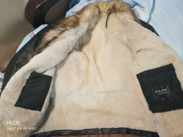 Продам Куртка тёплая мягкая {Kelaier} белый мех