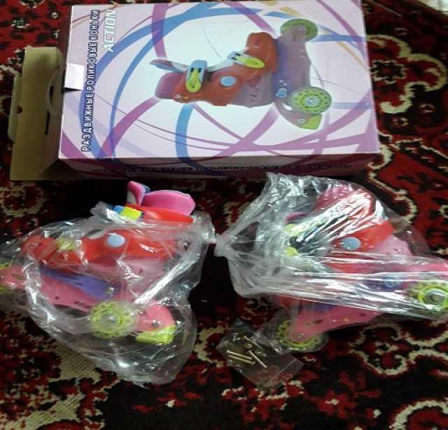 Продам: Детские роликовые коньки Action PW-125C