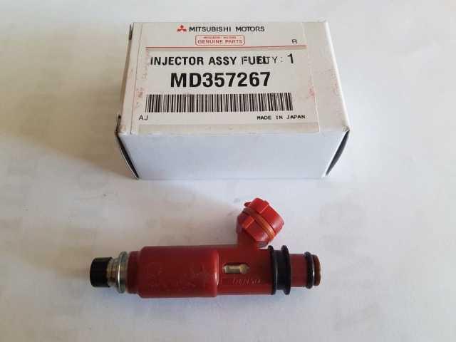 Продам: Топливные форсунки MD357267