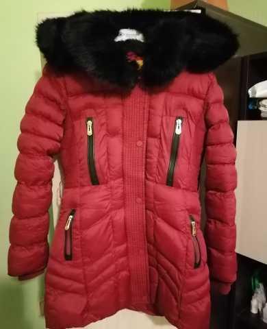 Продам: Зимнее пальто для девочки
