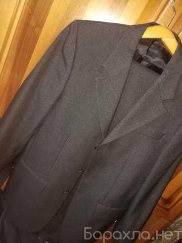 Продам: Новый черный костюм { Fessuto } полушерс